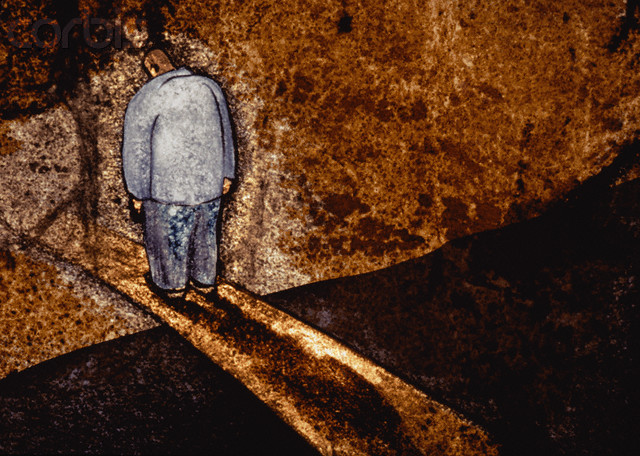 Man Standing on Pathway Between Darkness and Light