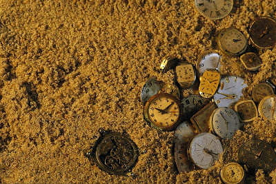 2-old-watch-faces-in-sand-the-sands-joel-sartore