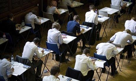 Pupils sit a GCSE exam