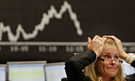 A broker reacts at the stock exchange in Frankfurt in September 2008 after the US crisis