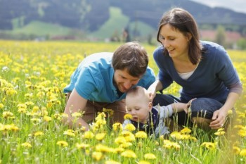Happy-family-in-spring-meadow