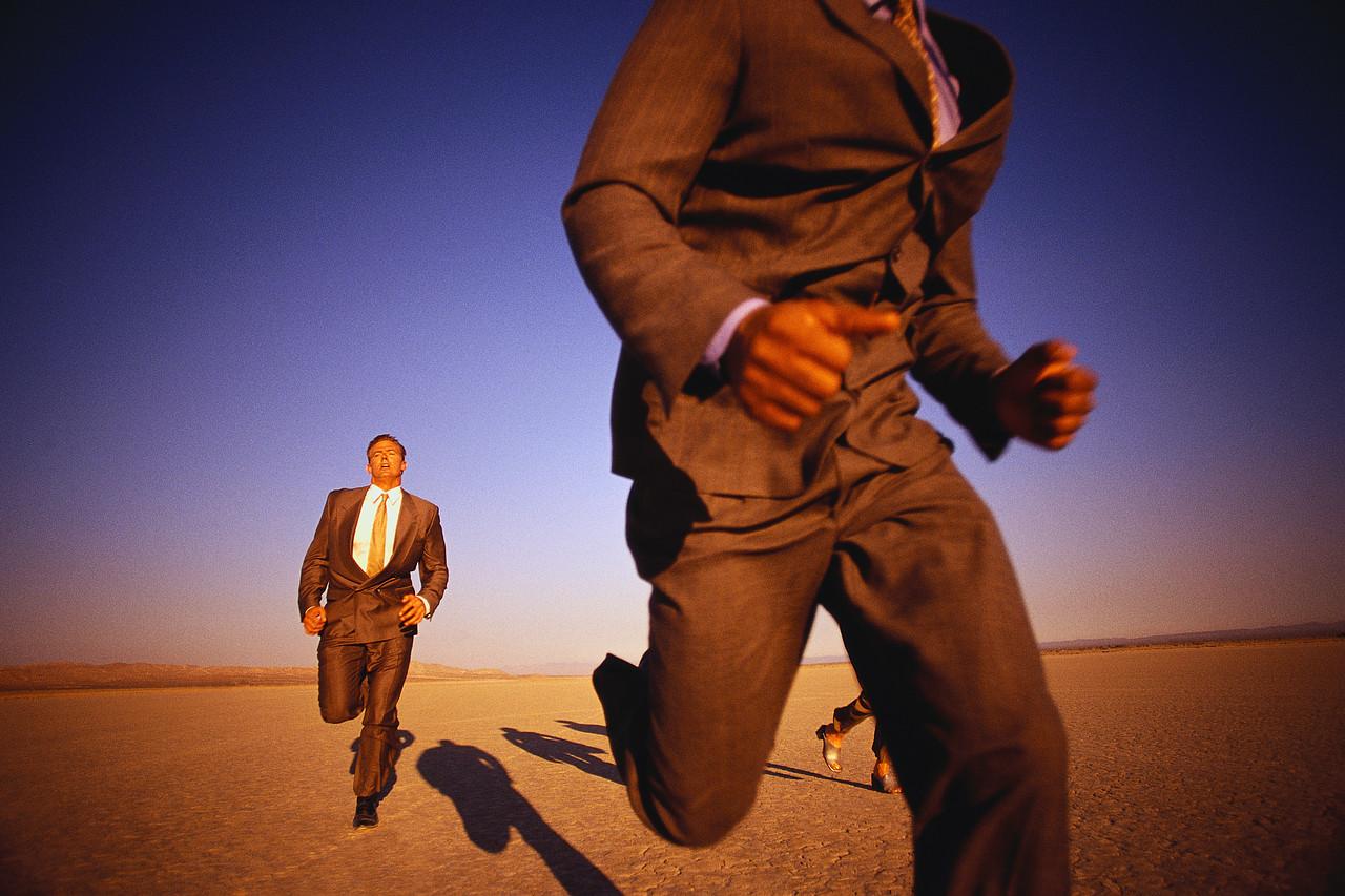 Businessman Running Through Desert