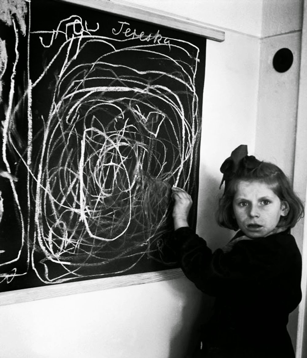 A girl who grew up in a concentration camp draws a picture of home while living in a residence for disturbed children, 1948