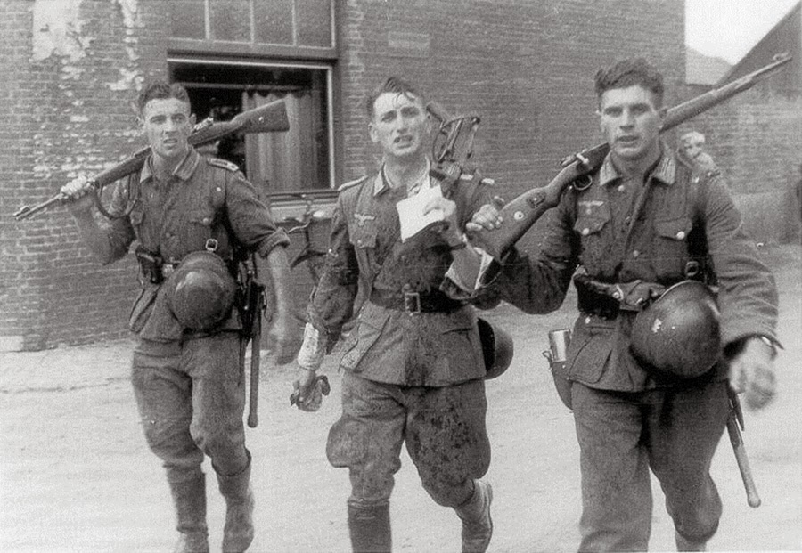 Three German soldiers returning from a recent fight