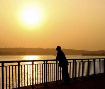 man-sunset-staring