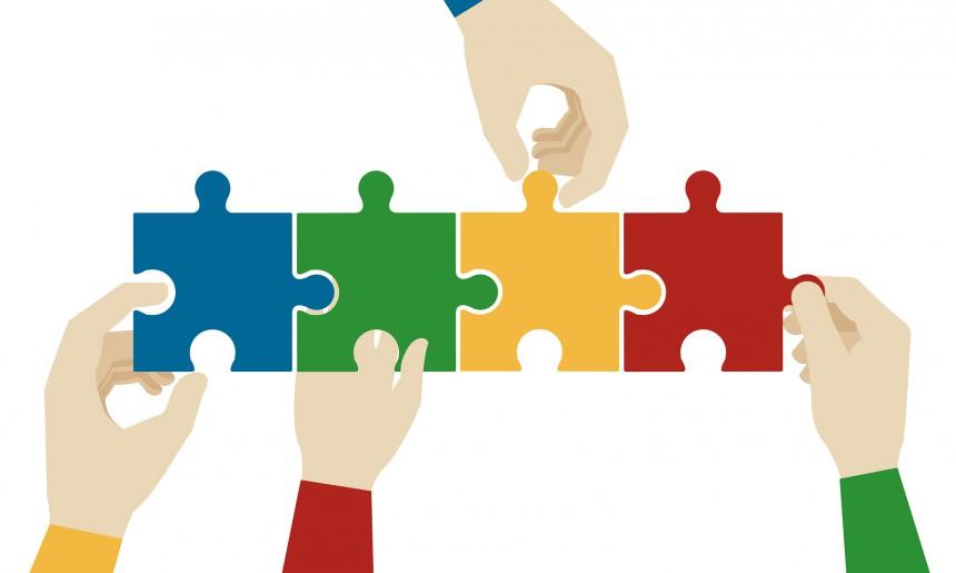 Hands-assembling-jigsaw-puzzle-94125488