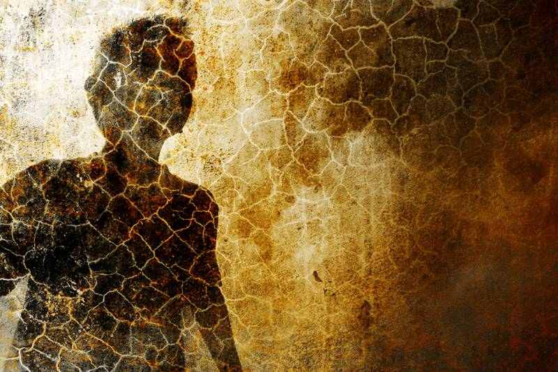 A young child silhouette on grunge background